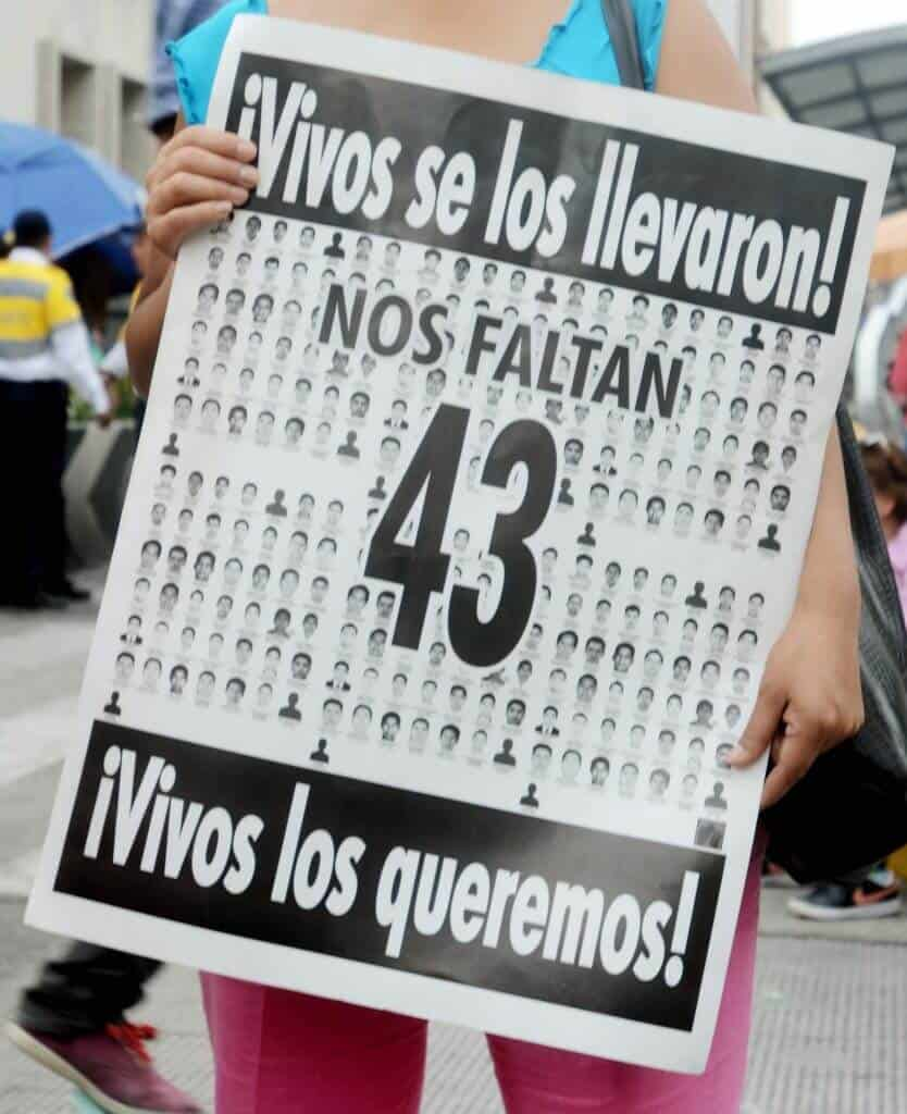 Selene Mendes , holds a sign in support of the 43 missing student during a march in Mexico City on May 26th 2015.